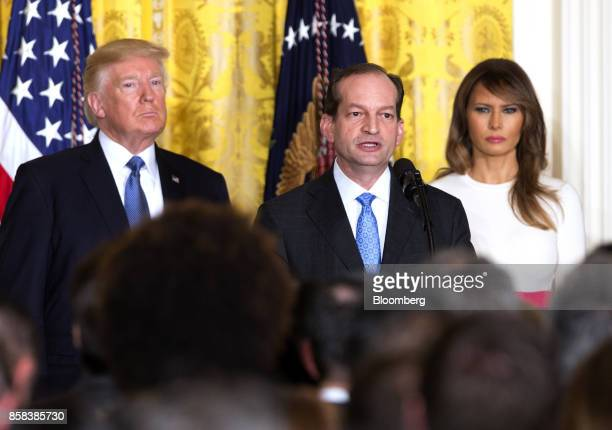 Alexander Acosta US labor secretary center speaks as US President Donald Trump left and US First Lady Melania Trump listen during an Hispanic...