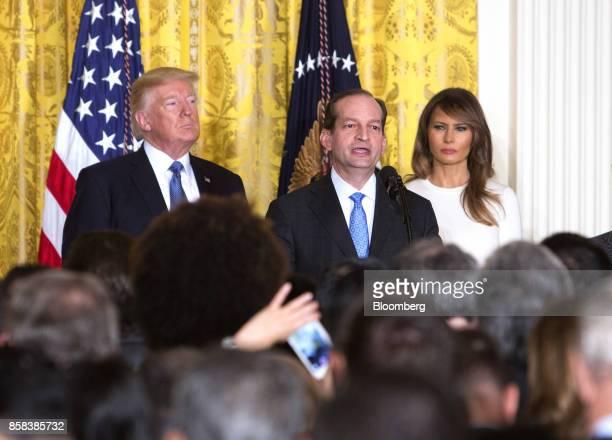 Alexander Acosta US labor secretary center speaks as US President Donald Trump left and US First Lady Melania Trump listen during an Hispanic...