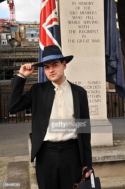Alexander Aicolina menswear designer wears Amish inspired Fedorat hat by Zara vintage shirt black Neoprene jacket by Zara and vintage Sicillian...