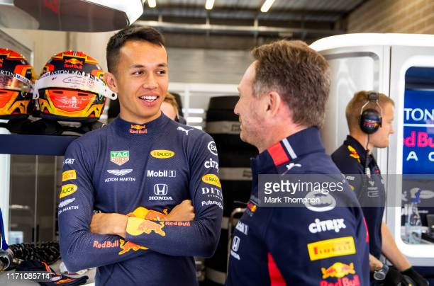 Alexander Albon of Thailand and Red Bull Racing and Red Bull Racing Team Principal Christian Horner talk in the garage during practice for the F1...
