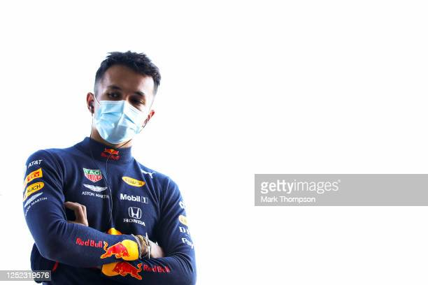 Alexander Albon of Thailand and Red Bull Racing looks on from the garage during the Red Bull Racing RB16 Filming Day at Silverstone Circuit on June...