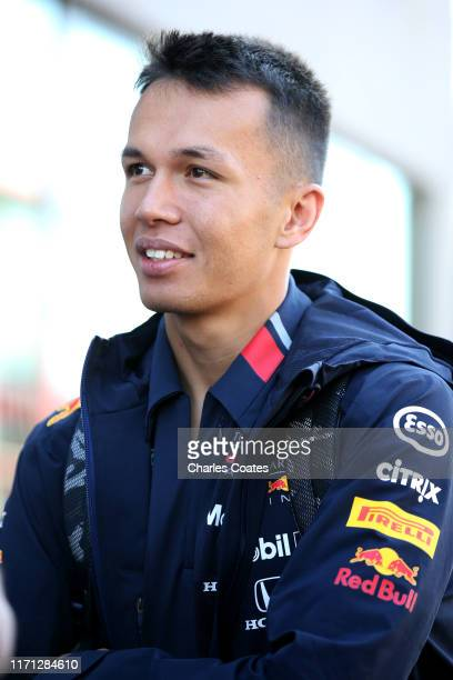 Alexander Albon of Thailand and Red Bull Racing looks on in the Paddock before final practice for the F1 Grand Prix of Belgium at Circuit de...