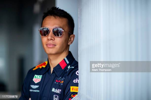 Alexander Albon of Thailand and Red Bull Racing looks on in the garage during previews ahead of the F1 Grand Prix of Russia at Sochi Autodrom on...