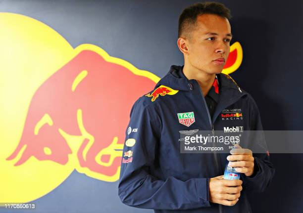 Alexander Albon of Thailand and Red Bull Racing looks on in the Red Bull Racing garage during previews ahead of the F1 Grand Prix of Belgium at...