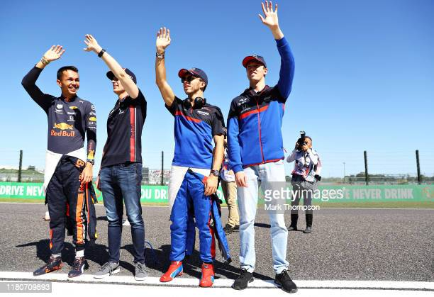 Alexander Albon of Thailand and Red Bull Racing Max Verstappen of Netherlands and Red Bull Racing Daniil Kvyat of Russia and Scuderia Toro Rosso and...