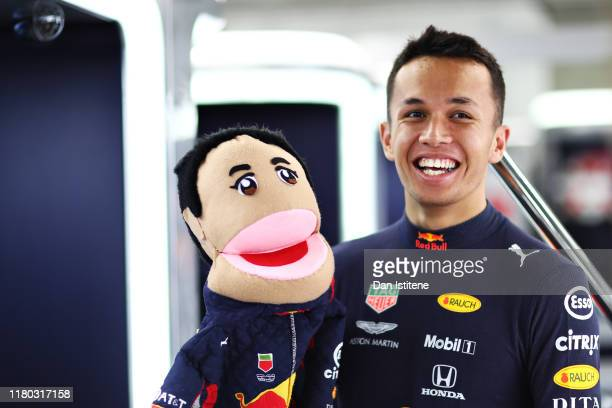 Alexander Albon of Thailand and Red Bull Racing prepares to drive in the garage before practice for the F1 Grand Prix of Japan at Suzuka Circuit on...