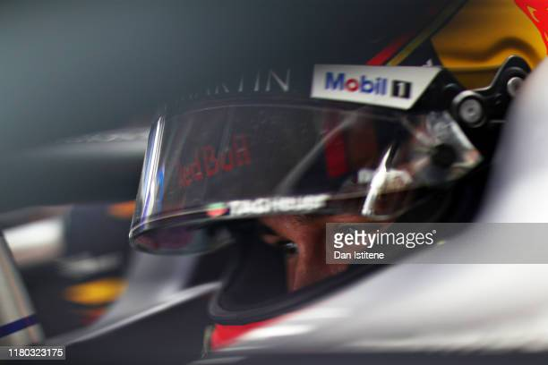 Alexander Albon of Thailand and Red Bull Racing prepares to drive in the garage during practice for the F1 Grand Prix of Japan at Suzuka Circuit on...