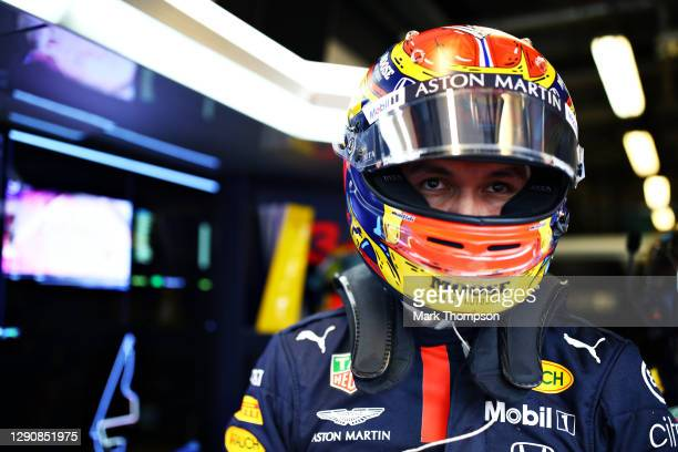 Alexander Albon of Thailand and Red Bull Racing prepares to drive in the garage during qualifying ahead of the F1 Grand Prix of Abu Dhabi at Yas...