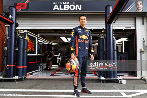 Alexander Albon of Thailand and Red Bull Racing stands in the Pitlane during previews ahead of the F1 Grand Prix of Belgium at Circuit de...