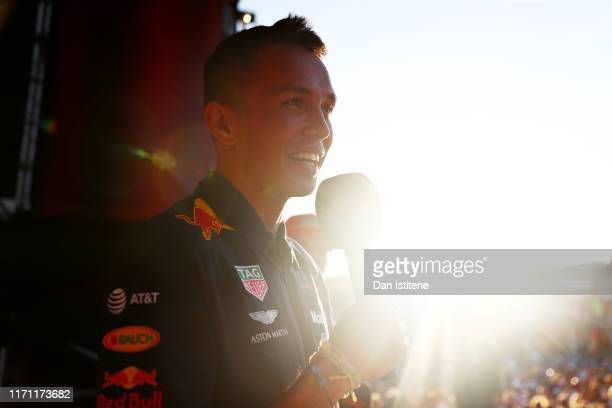 Alexander Albon of Thailand and Red Bull Racing talks to the crowd from the fan stage after practice for the F1 Grand Prix of Belgium at Circuit de...