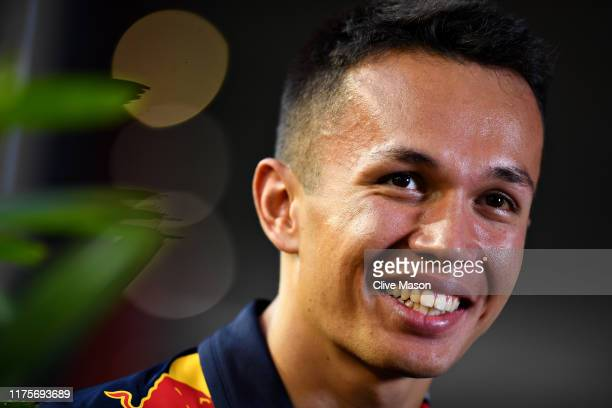 Alexander Albon of Thailand and Red Bull Racing talks to the media in the Paddock during previews ahead of the F1 Grand Prix of Singapore at Marina...