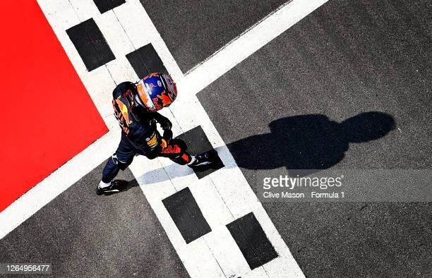 Alexander Albon of Thailand and Red Bull Racing walks in parc ferme after the F1 70th Anniversary Grand Prix at Silverstone on August 09, 2020 in...