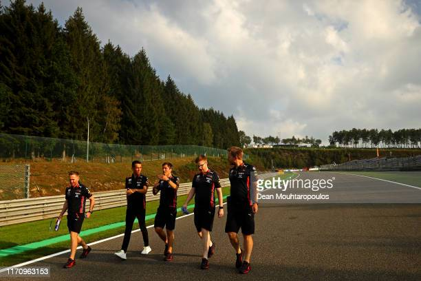 Alexander Albon of Thailand and Red Bull Racing walks the track with his engineers during previews ahead of the F1 Grand Prix of Belgium at Circuit...