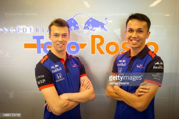 Alexander Albon of Thailand and Scuderia Toro Rosso and Daniil Kvyat of Russia and Scuderia Toro Rosso pose for a photo during day one of F1 End of...