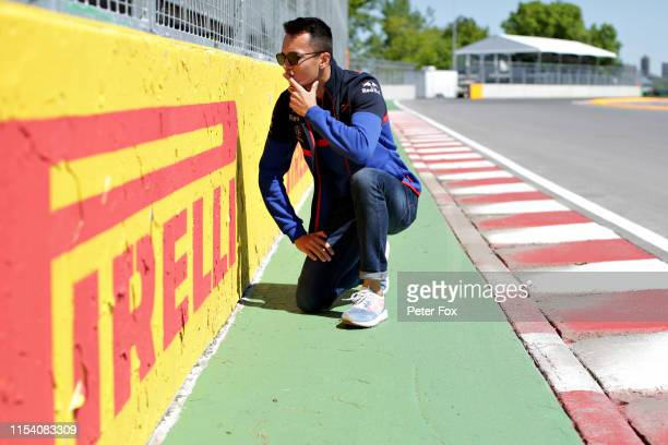 Alexander Albon of Thailand and Scuderia Toro Rosso inspects the Wall of Champions at the last corner of the circuit during previews ahead of the F1...