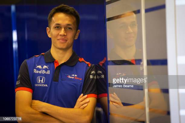 Alexander Albon of Thailand and Scuderia Toro Rosso poses for a photo during day one of F1 End of Season Testing at Yas Marina Circuit on November...