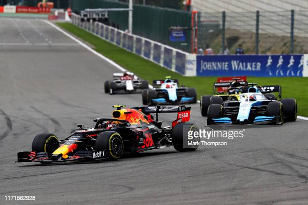 Alexander Albon of Thailand driving the Aston Martin Red Bull Racing RB15 leads George Russell of Great Britain driving the Rokit Williams Racing...
