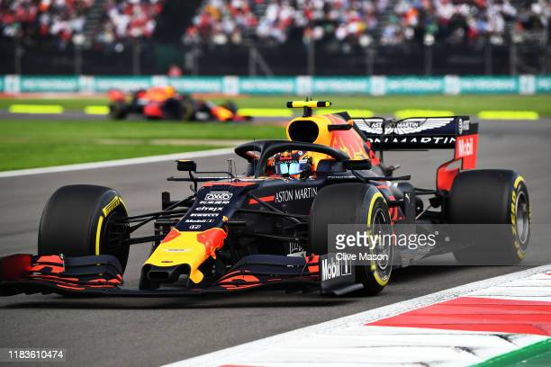 Alexander Albon of Thailand driving the Aston Martin Red Bull Racing RB15 leads Max Verstappen of the Netherlands driving the Aston Martin Red Bull...