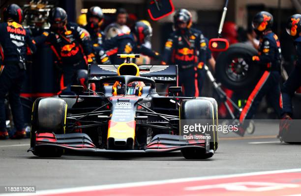 Alexander Albon of Thailand driving the Aston Martin Red Bull Racing RB15 makes a pitstop for new tyres during the F1 Grand Prix of Mexico at...