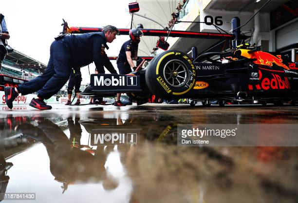 Alexander Albon of Thailand driving the Aston Martin Red Bull Racing RB15 is pushed back into his garage during practice for the F1 Grand Prix of...