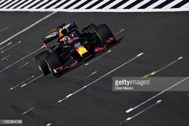 Alexander Albon of Thailand driving the Aston Martin Red Bull Racing RB16 on track during the Red Bull Racing RB16 Filming Day at Silverstone Circuit...