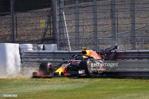 Alexander Albon of Thailand driving the Aston Martin Red Bull Racing RB16 crashes into a track barrier during practice for the F1 Grand Prix of Great...