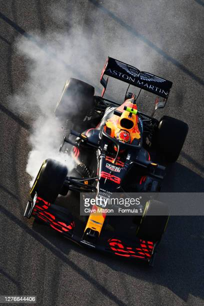 Alexander Albon of Thailand driving the Aston Martin Red Bull Racing RB16 locks a wheel under braking during practice ahead of the F1 Grand Prix of...
