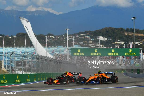 Alexander Albon of Thailand driving the Aston Martin Red Bull Racing RB16 battles for position with Lando Norris of Great Britain driving the McLaren...