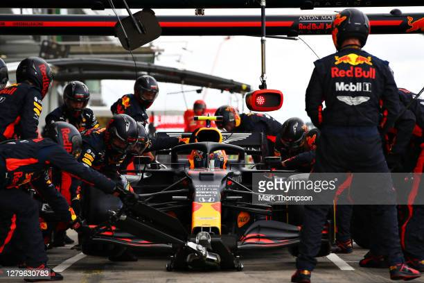 Alexander Albon of Thailand driving the Aston Martin Red Bull Racing RB16 makes a pitstop during the F1 Eifel Grand Prix at Nuerburgring on October...