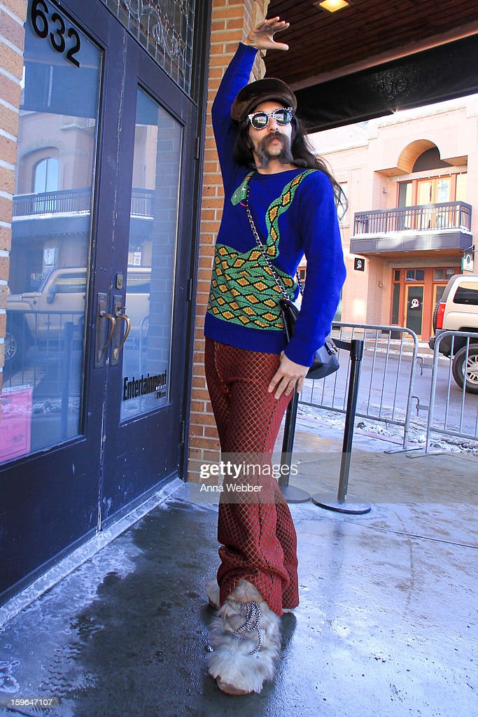 Alexander Antebi, lead singer of Conquistador from Los Angeles, wearing Vintage fur hat, Chanel quilted bag, custom sweater, custom boots, and Zan Zan sunglasses on January 17, 2013 on the streets of Park City, Utah.