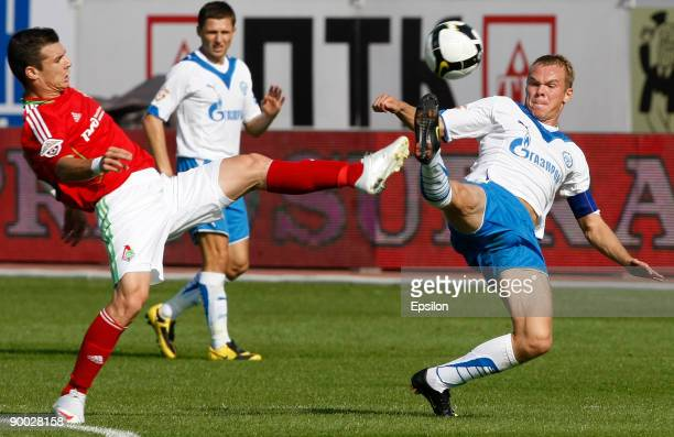 Alexander Anyukov of FC Zenit St Petersburg battles for the ball with Wagner of FC Lokomotiv Moscow during the Russian Football League Championship...