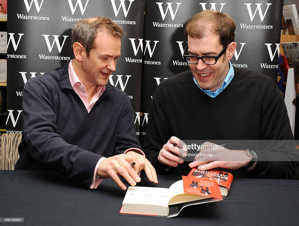 Alexander Armstrong and Richard Osman meet fans and sign copies of 'The 100 Most Pointless Arguments In The World' at Waterstones Leadenhall on December 11, 2013 in London, England.