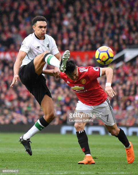 Alexander Arnold of Liverpool competes for the ball with Alexis Sanchez of Manchester United during the Premier League match between Manchester...