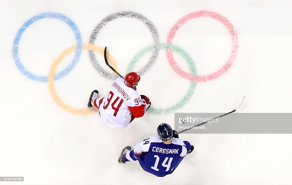 Alexander Barabanov #94 of Olympic Athlete from Russia and Peter Ceresnak #14 of Slovakia compete for the puck in the first period during the Men's Ice Hockey Preliminary Round Group B game on day five of the PyeongChang 2018 Winter Olympics at Gangneung Hockey Centre on February 14, 2018 in Gangneung, South Korea.