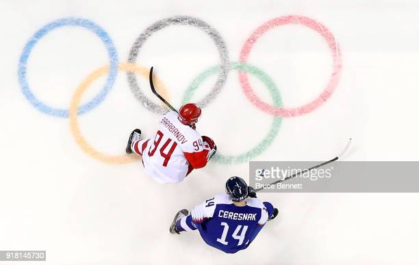 Alexander Barabanov of Olympic Athlete from Russia and Peter Ceresnak of Slovakia compete for the puck in the first period during the Men's Ice...