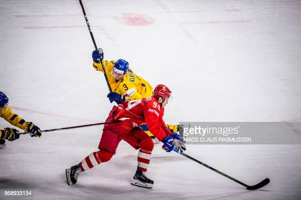 Alexander Barabanov of Russia and John Klingberg of Sweden vie during the IIHF World Championship group A ice hockey match between Russia and Sweden...