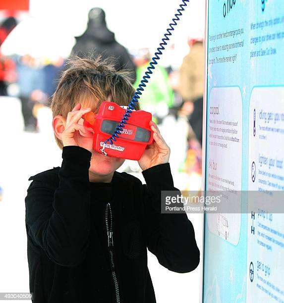 Alexander Baribeau of Bethel looks through a ViewMaster at a ski bus that runs on recycled vegetable oil at the Clif Bar tent The display was part of...