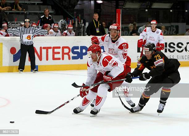 Alexander Barta of Germany fights for the puck with Jesper Daamgard and Mads Christensen of Denmark during the IIHF World Ice Hockey Championship...