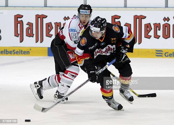 Alexander Barta of Germany in action with Robert Lukas of Austria during the friendly game between Germany and Austria at the Eissporthalle am...