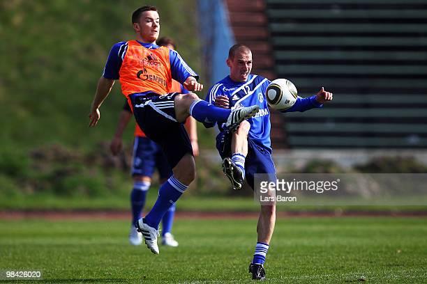 Alexander Baumjohann challenges Peer Kluge during a FC Schalke 04 training session on April 13 2010 in Gelsenkirchen Germany