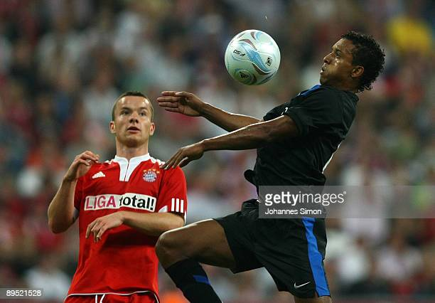 Alexander Baumjohann of Bayern and Nani of Manchester fight for the ball during the Audi Cup tournament final match FC Bayern Muenchen v Manchester...
