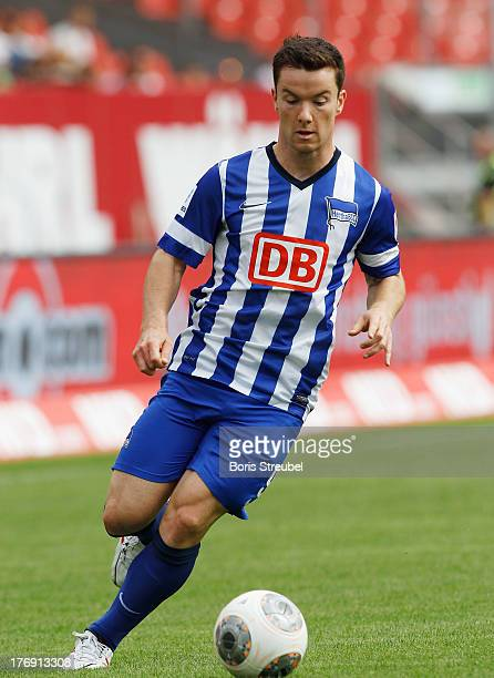 Alexander Baumjohann of Berlin runs with the ball during the Bundesliga match between 1 FC Nuernberg and Hertha BSC Berlin at Grundig Stadium on...