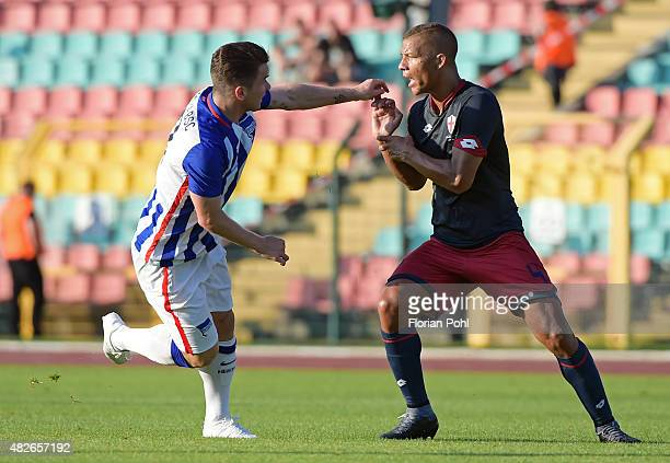 Alexander Baumjohann of Hertha BSC and Sebastien De Maio of CFC Genua have a fight during the game between Hertha BSC and CFC Genua on august 1 2015...