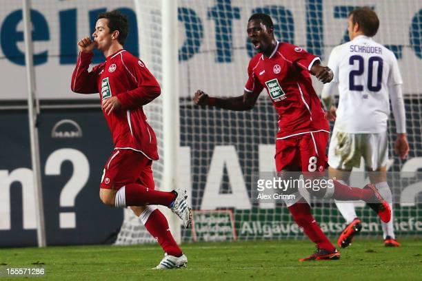 Alexander Baumjohann of Kaiserslautern celebrates his team's second goal with team mate Mohamadou Idrissou during the Second Bundesliga match between...