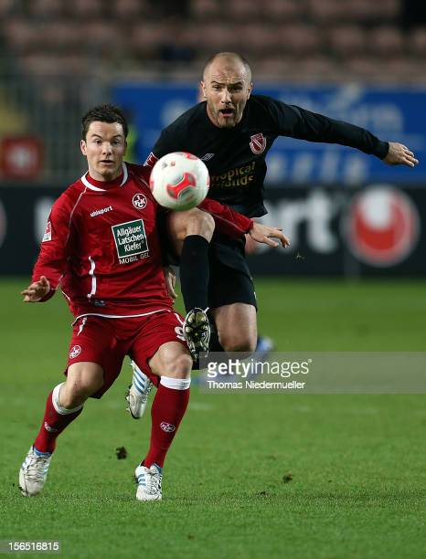 Alexander Baumjohann of Kaiserslautern fights for the ball with Ivica Banovic of Cottbus during the Second Bundesliga match between 1 FC...