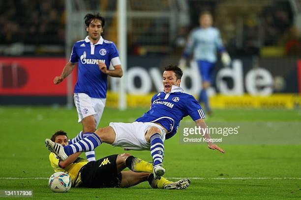 Alexander Baumjohann of Schalke falls over Sebastian Kehl of Dortmund during the Bundesliga match between Borussia Dortmund and FC Schalke 04 at...