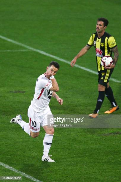Alexander Baumjohann of the Wanderers celebrates after scoring a goal while Tom Doyle of the Phoenix looks on during the round three ALeague match...
