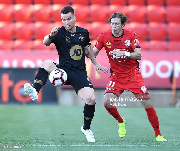 Alexander Baumjohann of the Wanderers competes with Craig Goodwin of Adelaide United during the round nine ALeague match between Adelaide United and...