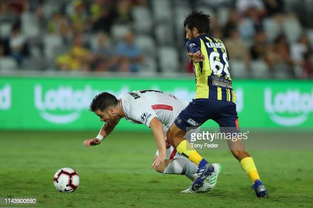 Alexander Baumjohann of the Western Sydney Wanderers contests the ball with Jem Karacan of the Central Coast Mariners during the round 26 A-League...