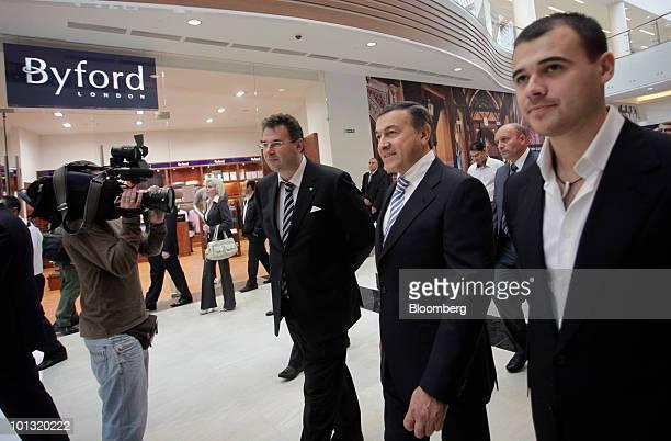 Alexander Bazarov vicepresident of Sberbank left Aras Agalarov center owner of Crocus Group and his son Emin Agalarov coowner of the Vegas mall walk...